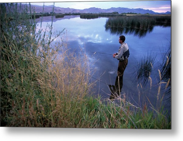 A Man Fly Fishing On A Remote River Metal Print