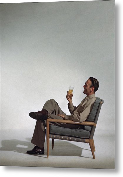 A Man Sitting In An Armchair With A Drink Metal Print