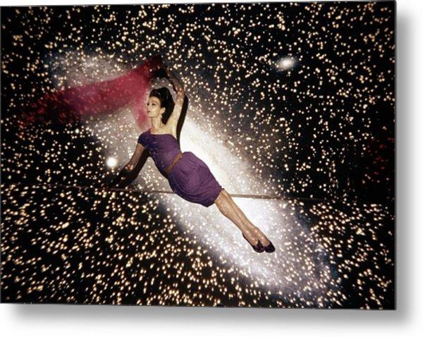 A Model Against A Galaxy Backdrop Metal Print by John Rawlings