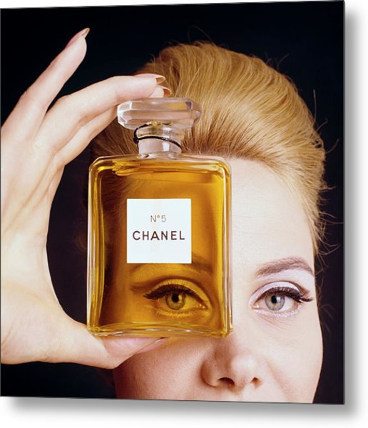 A Model Holding A Bottle Of Perfume Metal Print