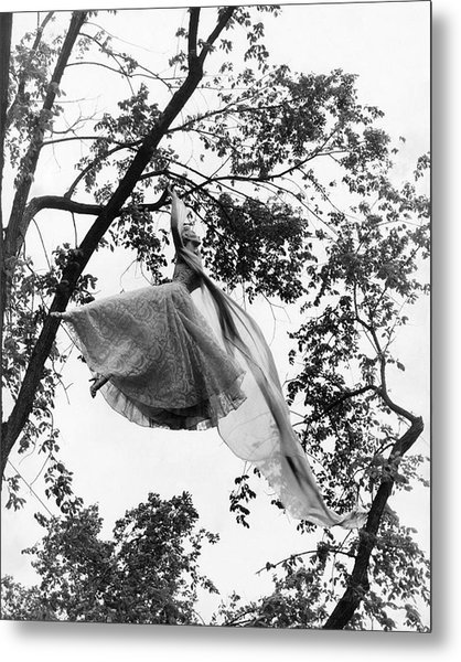 A Model Wearing A Dress In A Tree Metal Print