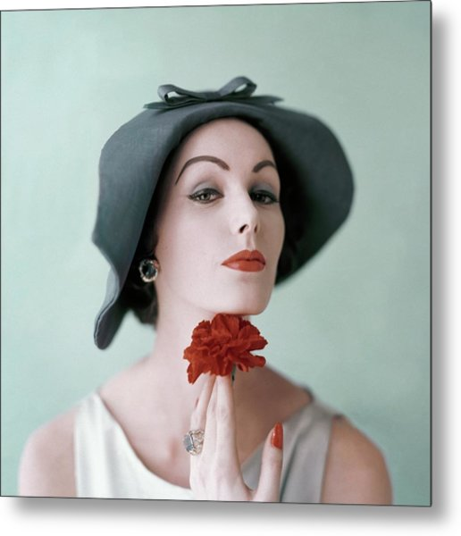 A Model Wearing A Hat And Holding A Flower Metal Print