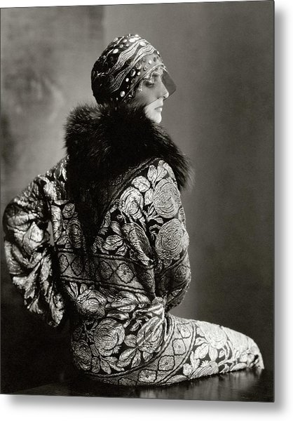 A Model Wearing A Headdress And Brocade Coat Metal Print