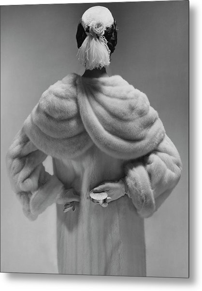A Model Wearing A Mink Coat Metal Print