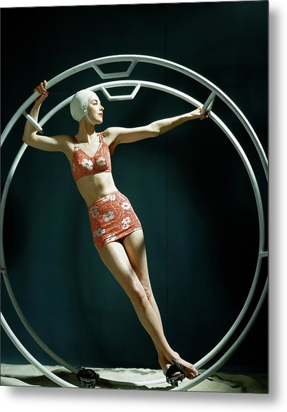 A Model Wearing A Swimsuit In An Exercise Ring Metal Print by John Rawlings