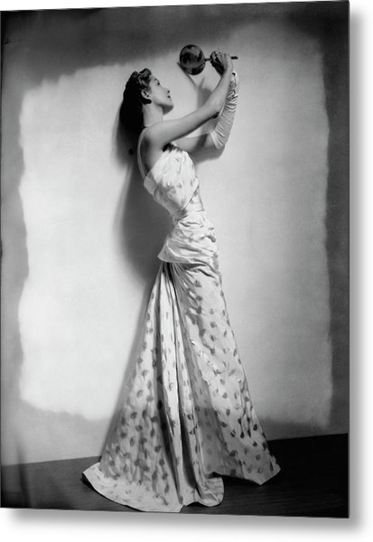 A Model Wearing Leaf Patterned Dress Metal Print by Cecil Beaton