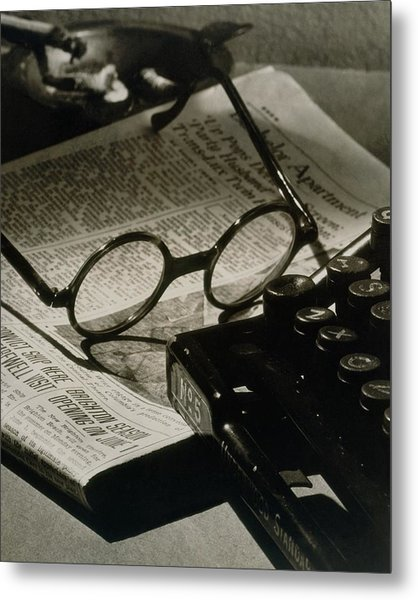 A Pair Of Glasses On Top Of A Newspaper Metal Print
