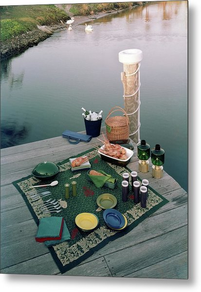 A Picnic Set Up On A Dock Metal Print