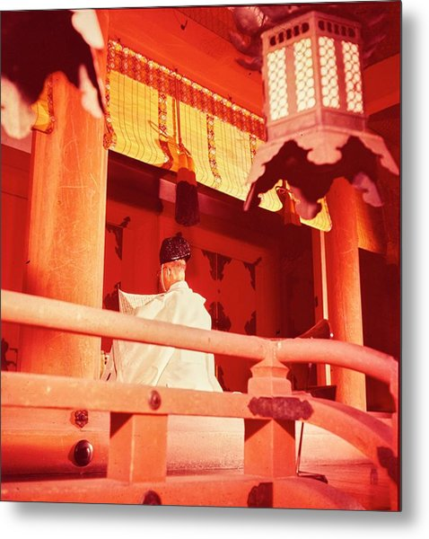 A Priest Praying In A Shinto Shrine Metal Print
