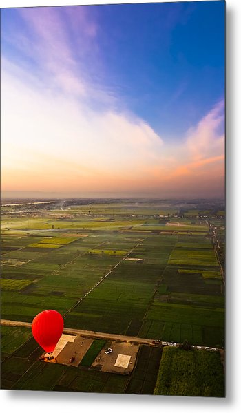 A Red Hot Air Balloon Landing In Egyptian Fields Metal Print by Mark E Tisdale