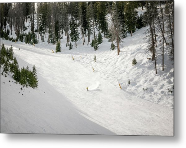 A Skier On A Snow Covered Ski Hill Metal Print