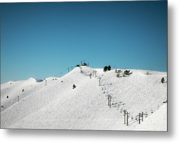 A Snow Covered Ski Hill And Lift Metal Print