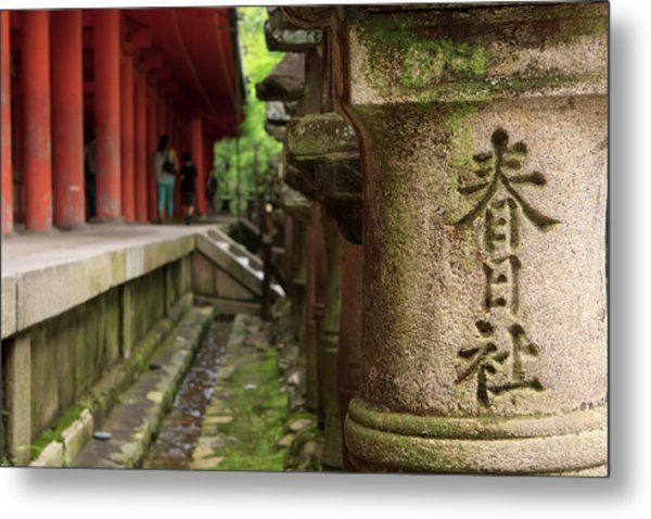 A Stone Pillar Which Reads Kasuga Metal Print by Paul Dymond