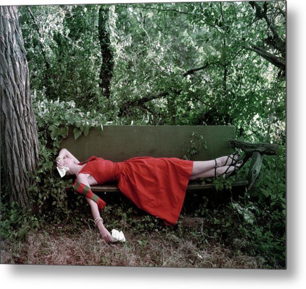 A Woman Lying On A Bench Metal Print
