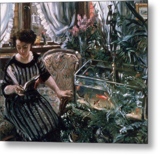 A Woman Reading Near A Goldfish Tank Metal Print