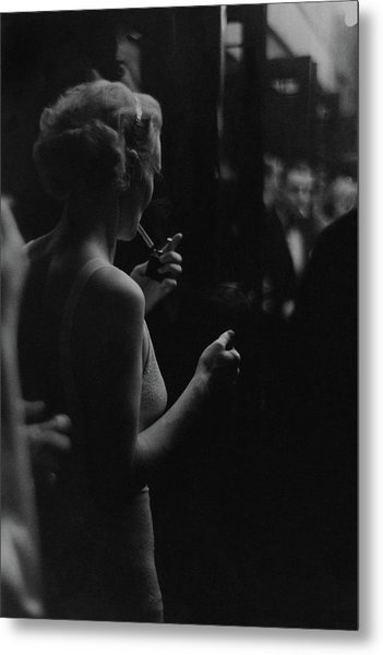 A Woman Smoking At The Music Box Metal Print by Remie Lohse