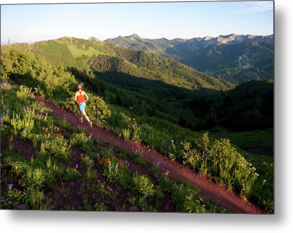 A Woman  Trail Running On The Crest Metal Print