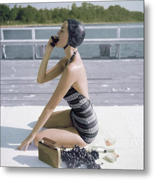 A Young Woman Wearing A Swimsuit Eating Grapes Metal Print