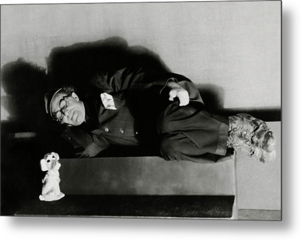 Actor Ed Wynn Lying Down On A Bench In 'the Laugh Metal Print by Florence Vandamm