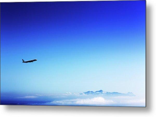 Aeroplane Flying In A Clear Blue Sky Metal Print by Wladimir Bulgar