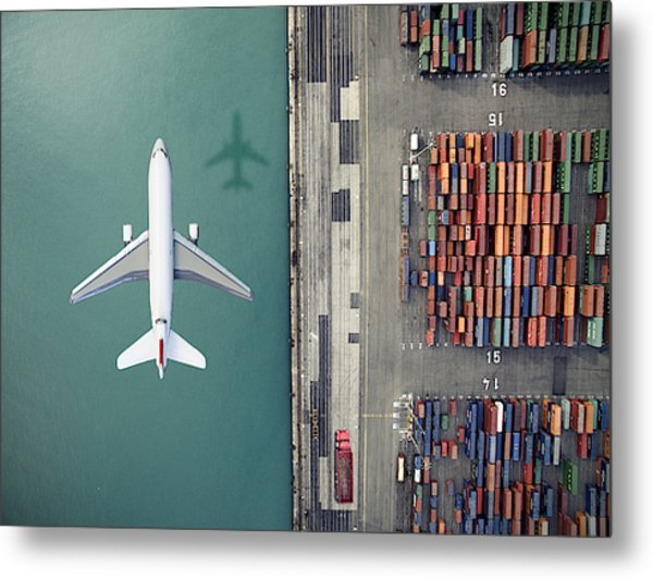 Airplane Flying Over Container Port Metal Print by Orbon Alija