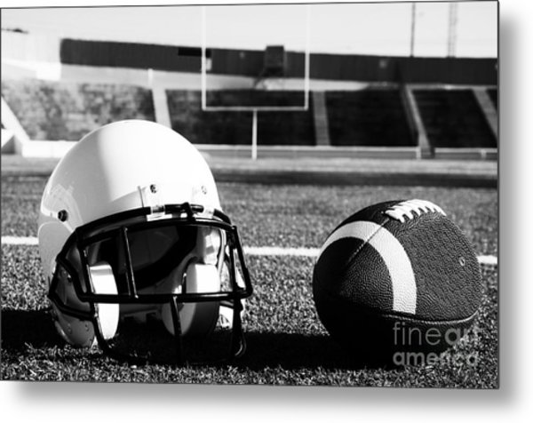 American Football And Helmet On Field Metal Print