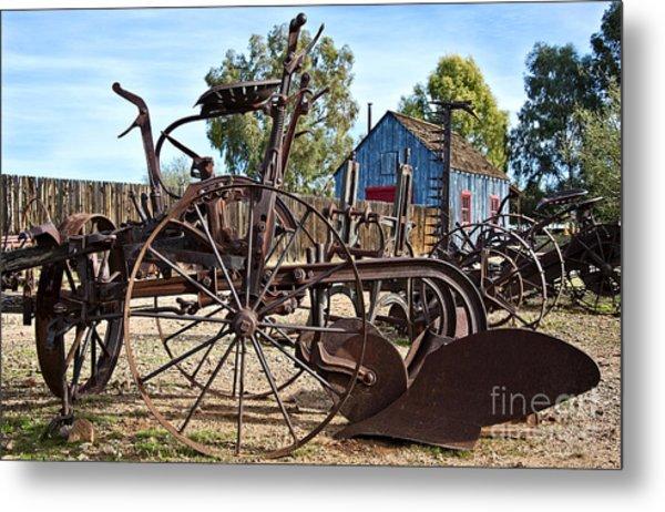 Antique Farm Equipment End Of Row Metal Print by Lee Craig