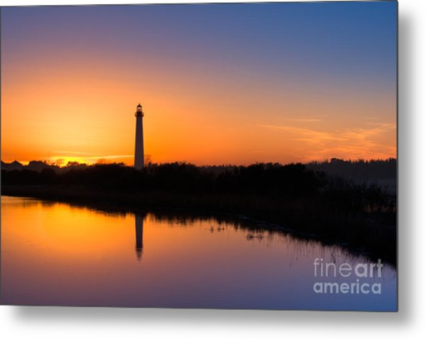 As The Sun Sets And The Water Reflects Metal Print