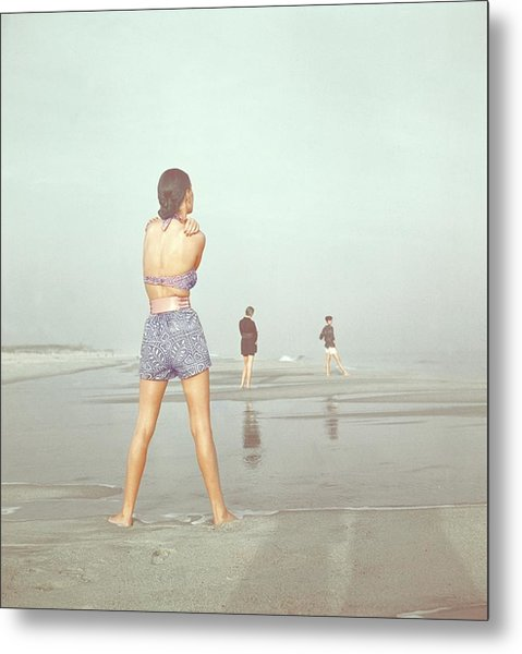 Back View Of Three People At A Beach Metal Print by Serge Balkin