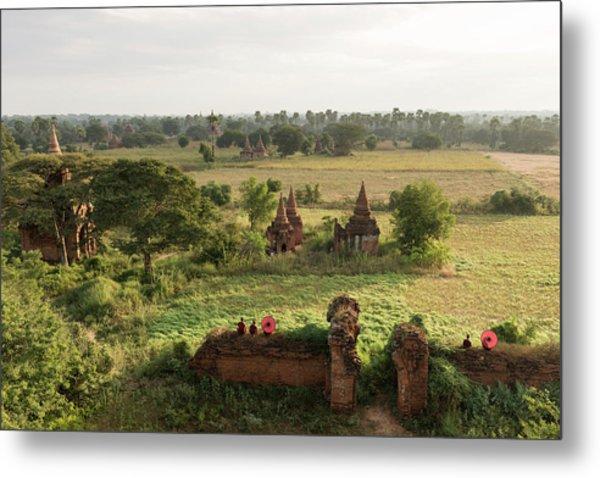 Bagan, Buddhist Monks Sitting Amongst Metal Print by Martin Puddy