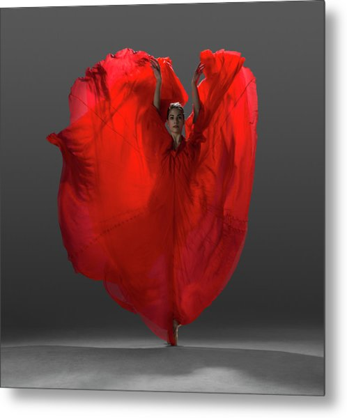 Ballerina On Pointe With Red Dress Metal Print by Nisian Hughes