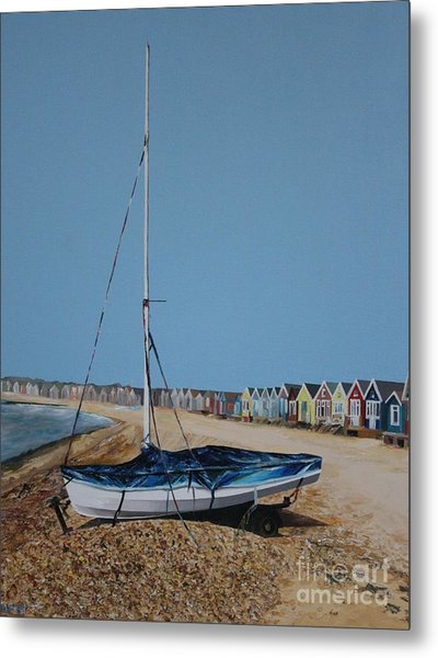 Beach Huts And Boat On The Spit Metal Print by Linda Monk