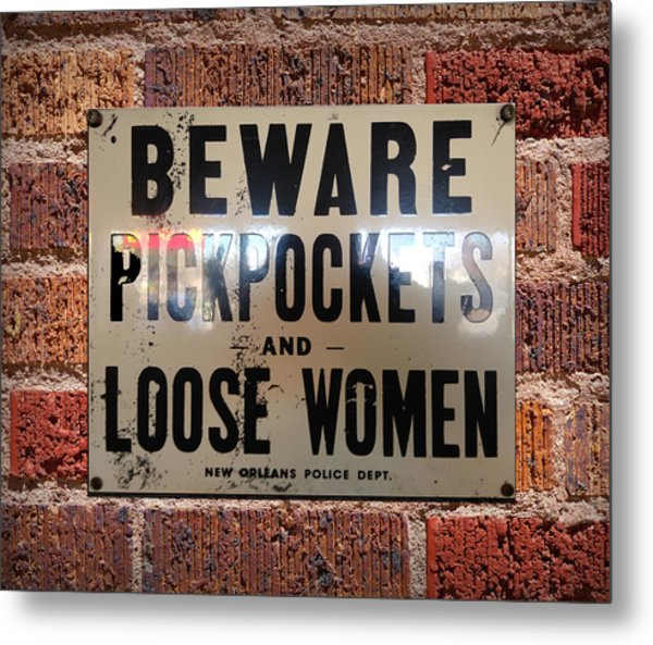 Beware Pickpockets And Loose Women Sign On Brick Wall Metal Print