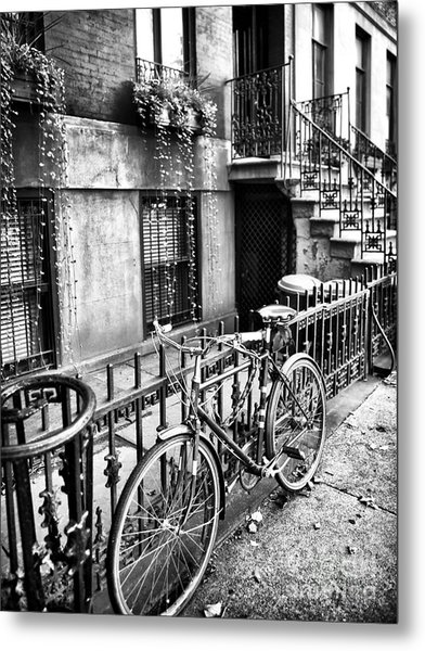 Bicycle In The Village Metal Print by John Rizzuto