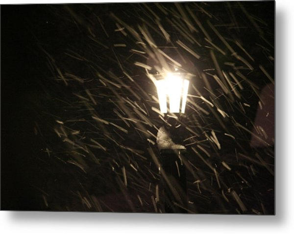 Blowing Snow Against Lamp Metal Print by Carolyn Reinhart