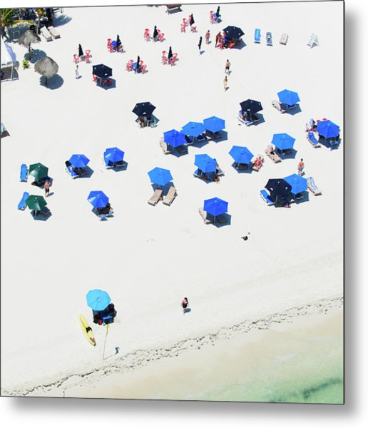 Blue Umbrellas On A Sunny Beach Metal Print by Tommy Clarke