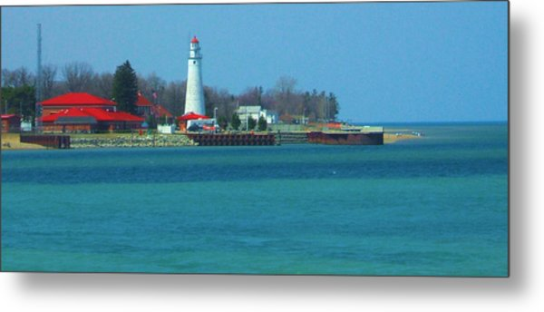 Blue Water Lighthouse Metal Print by Peg Holmes
