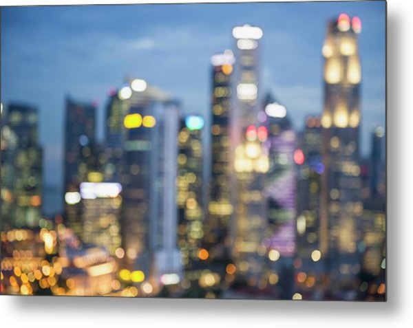 Blurred View Of City Skyline Lit Up At Metal Print by Jacobs Stock Photography Ltd