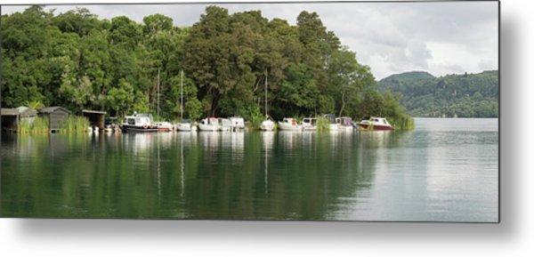 Boats Docked Along Edge Of Lake Metal Print