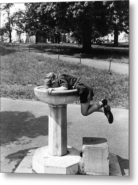 Boy Drinking From Fountain Metal Print
