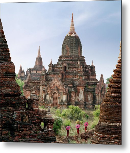 Buddhist Monks Walking Past Temple Metal Print by Martin Puddy