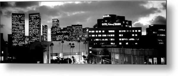 Building Lit Up At Night In A City Metal Print