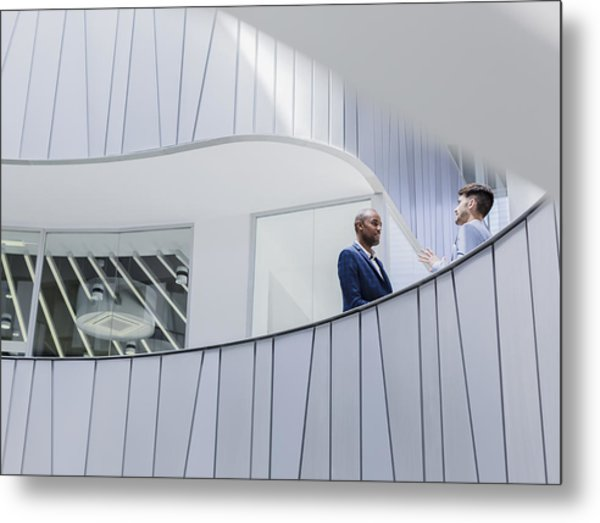 Businessmen Talking On Architectural, Modern Office Balcony Metal Print by Caiaimage/Martin Barraud
