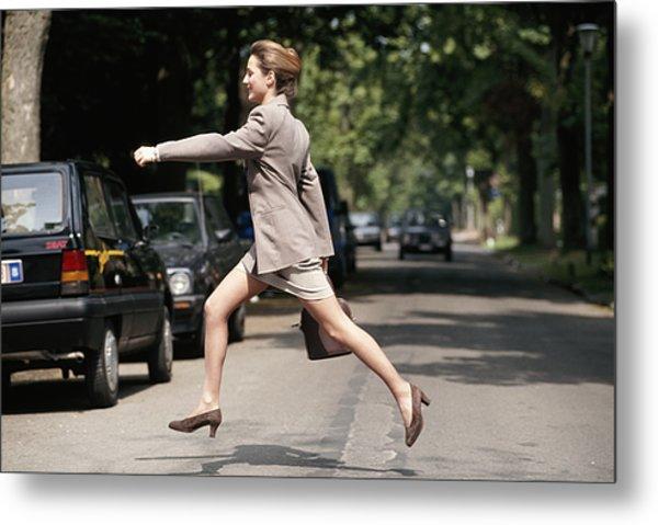 Businesswoman Running Across Road, Side View Metal Print by David De Lossy