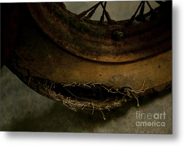 Busted Motorcycle Tire Metal Print