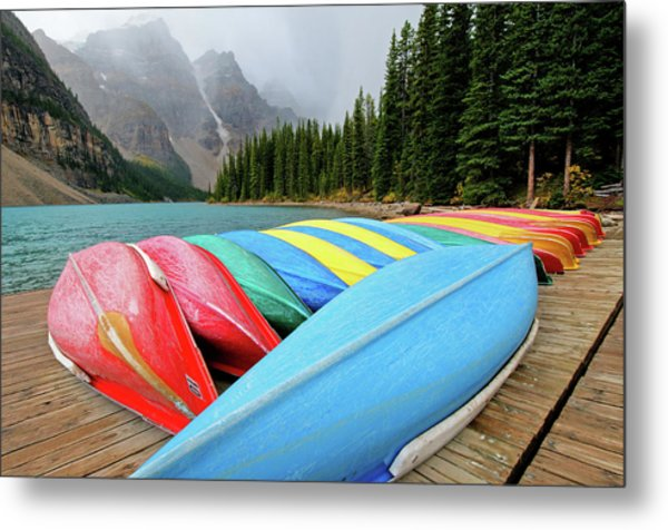 Canoes Line Dock At Moraine Lake, Banff Metal Print by Wildroze