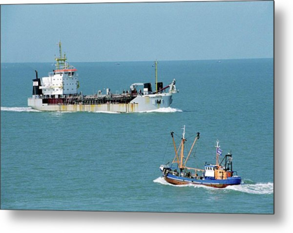 Cargo Ship And Fishing Boat Metal Print by Christophe Vander Eecken/reporters/science Photo Library