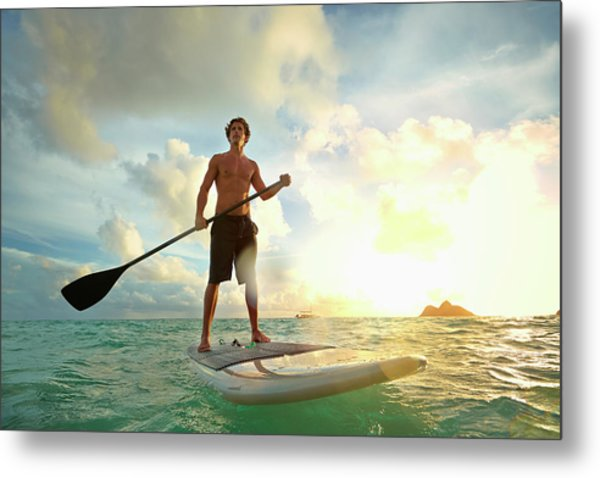 Caucasian Man On Paddle Board In Water Metal Print by Colin Anderson Productions Pty Ltd