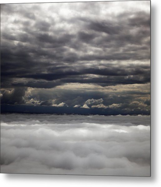 Caught Between Two Cloud Layers Metal Print by Michael Riley