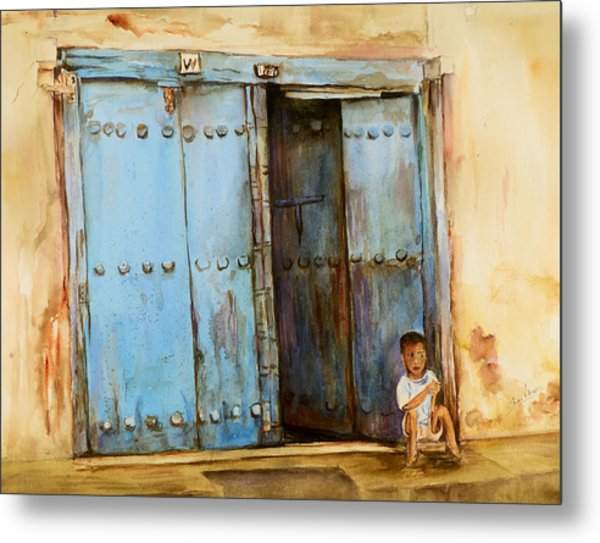 Child Sitting In Old Zanzibar Doorway Metal Print